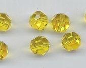 Twelve rare vintage Swarovski crystals: art 5000 - 8 mm - citrine AB