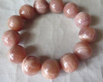 Luminous Smooth Peach Moonstone Stretch Bracelet with 14mm Round Stones