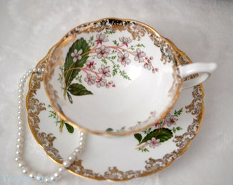 English Bone China Teacup And Saucer Set With Floral Decoration, ca. unknown
