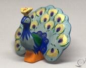 Toy Peacock wooden colourful bluegreen handmade Size: 7,0 x 9,0  x 11,0 cm (bxhxs)  approx. 45,5 gr.