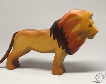 Toy lion wooden yellow brown colourful  sitting Size: 18,7 x 12,0 x 3,2 cm (bxhxs)  ca. 160,0 gr.