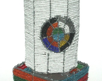 Wire beaded Wine or Alcohol Stand hand crafted in Africa. Unique colorful designer stand.