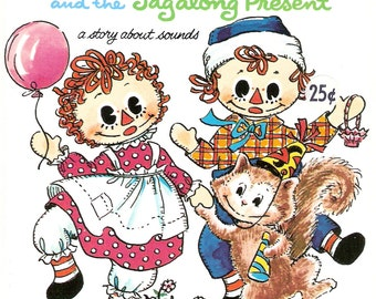 Raggedy Ann and the Tagalong Present Vintage Whitman Tell A Tale Book by Marjory Schwalje Illustrated by Becky Krehbiel