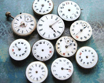 Collection Of Antique Enamel Faced Watch Movements, Trench Red 12 c1910 x 11
