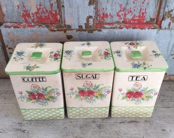 Set of three lettered, floral ceramic canisters, green trim, 40's era