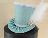 Elsa Frozen Inspired Mad Hatter Mini Top Hat. Great for Birthday Parties, Tea Parties, Photo Prop, Girls Night Out and Much More...