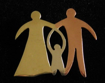 Family Mixed Metal Brooch is a Modernist Unsigned Artisan Piece in Copper, Brass, & Silver Showing Mother, Child, Father.