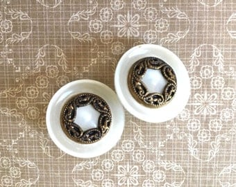 2 Pretty Vintage Plastic Buttons with Metal Designs