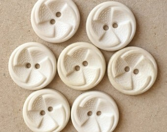 vintage white and cream buttons with pinwheel design--matching lot of 7