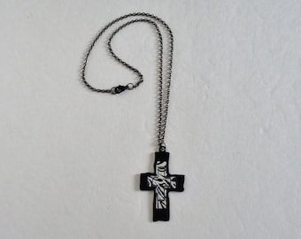Black enameled metal cross with a black chain and black closure