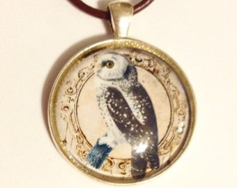 Owl pendant in silvertone, with brown leather cord necklace