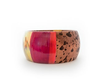 Multimedia high impact color with gold wood bangle