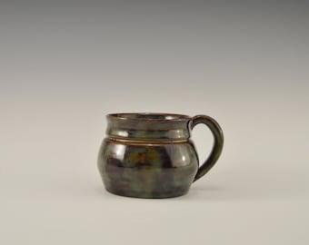 Ceramic coffee mug in a mottled green glaze, Stoneware coffee mug