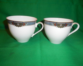 Two (2), Flat Cups. from Christopher Stuart, in the Barclay Pattern.