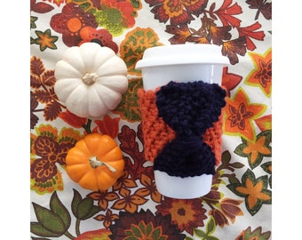 KNIT CUP COZY - The Pumpkin Spice Latte series - Orange Cozy with Navy Blue Knit Bow, Mug Sleeve, Knitted Mug Cozy, Reusable cup sleeve