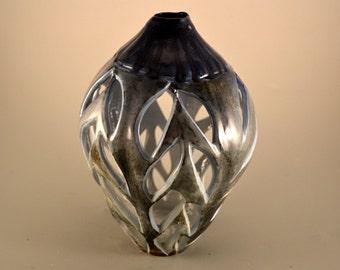 Running on empty- handmade porcelain, carved/bottle/colbolt blue and gray highlight/luminary