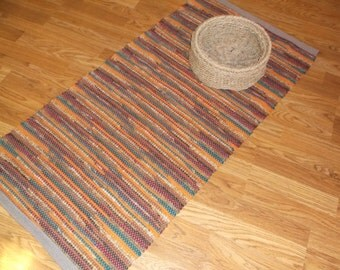 Hand-woven, Rag Rug, made with Recycled linens and sewing scrapes, done in fall colors.