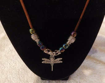 Dragonfly necklace on brown cord with iridescent beads and silver spacers