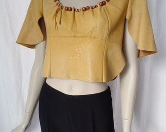 70s cropped leather top with leather cord wood beads/natural cowhide/Music festival style: medium