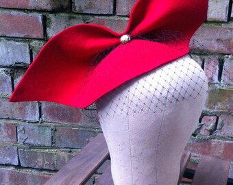 Oversized red bow headpiece