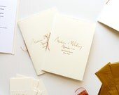 Simple foil printed book-fold wedding programs on archival heavy weight paper, hand deckled and hand sewn.