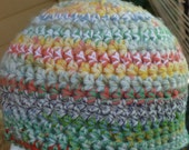 """Crochet beanie hat is a """"Keep it Simple""""  style with stripes in pastel light shades Yellow Green Blue"""