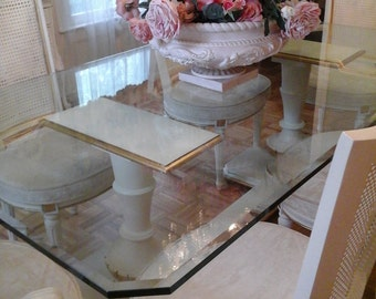 Vintage glass dining room table with cane back chairs