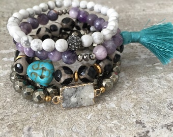 Purple beaded bracelet with turquoise silk tassel