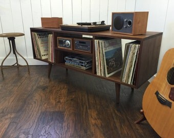 New mid century modern record player console, turntable, stereo cabinet with LP album storage featuring black walnut with tapered wood legs.
