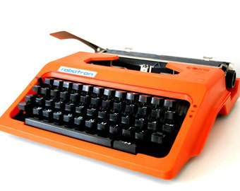 Vintage. Orange. Typewriter from East Germany. Mid Century. DDR.  Robotron (TY101)