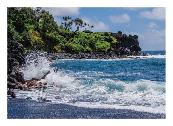 Wave Splash on Black Sand Beach in Maui, Hawaii