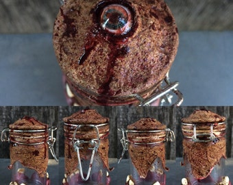 Human Flesh Jar size small. w/ grey & pink eye