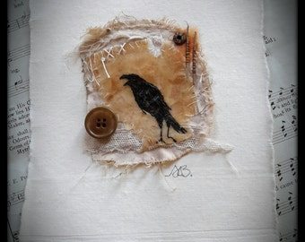 crow art encaustic beeswax teabag ink drawing on hand dyed textile with vintage lace and button unique quirky  soft browns mixed media art