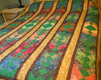 Queen size quilt with braided quilt pattern ready to ship, features lovely shades of greens, blues, golds and reds.