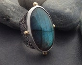 Large blue green labradorite ring, wide ornate sterling silver band, pure silver bezel and 4 gold colored brass balls, fits size 7.5