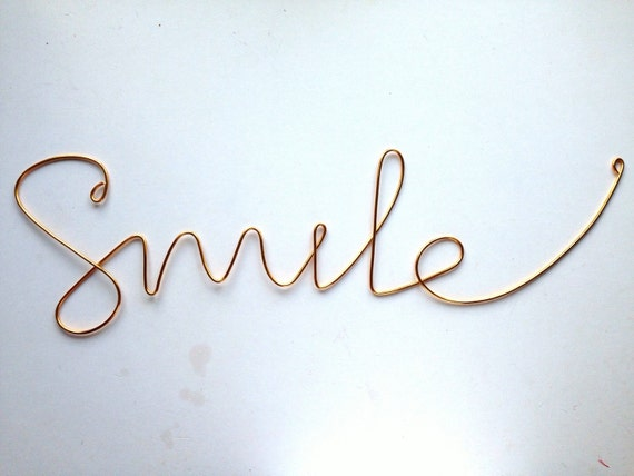 """Items similar to Thick cursive """"Smile"""" wall phrase gold ..."""