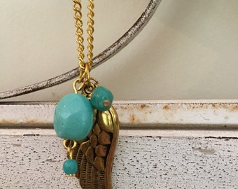 Long gold feather charm necklace with turquoise accent beads
