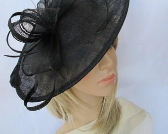 Black  Feather Fascinator..Stunning shaped Fascinator on a Headband..