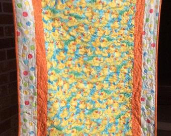 Baby duckies in the rain baby quilt