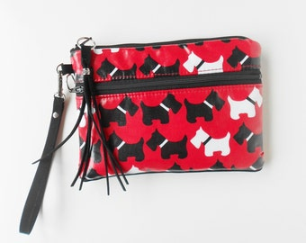 Red wristlet or clutch in water resistant laminate, with cheerful scotty dogs!