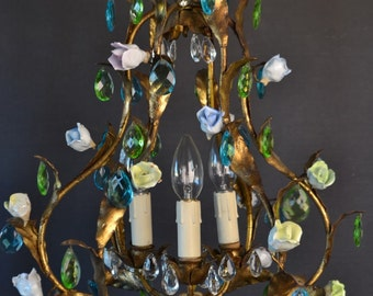 Beautiful old golden tole chandelier with different colours glass drops and roses.
