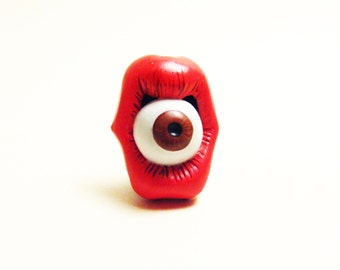 Mouth and eye brown lapel pin