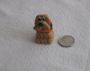 Miniature carved dog