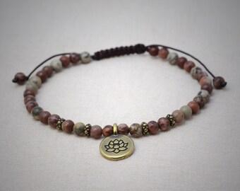 Apache jasper bracelet with antique brass lotus flower charm - macrame closure