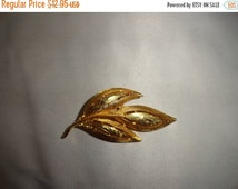 50% OFF Leaf Brooch Gold toned 1.5 in by 2.5 in Heavy metal