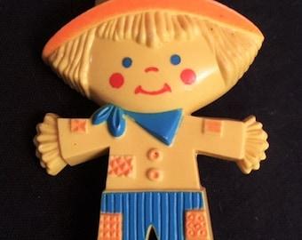 Avon 1975 Scarecrow Fragrance Glace pin