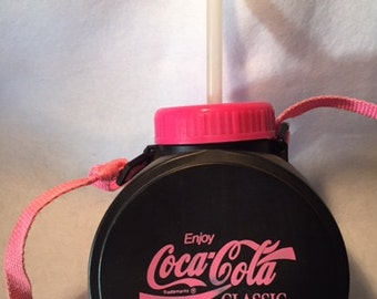 Coca Cola black and pink plastic canteen with straw