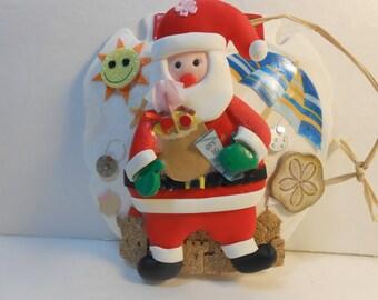 suntan santa sand dollar ornament