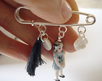 silvertone brooch with porcelain doll