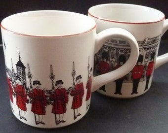 Rare PAIR  of Midwinter London Scenes Mug: One with Beefeaters at Tower of London; the other with Guardsmen at Buckingham Palace
